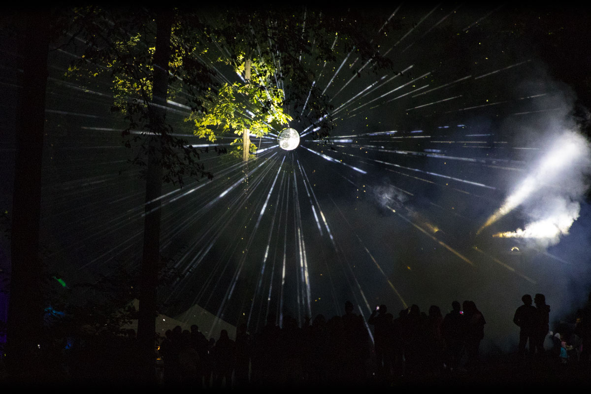 Disco ball refracting with a crowd